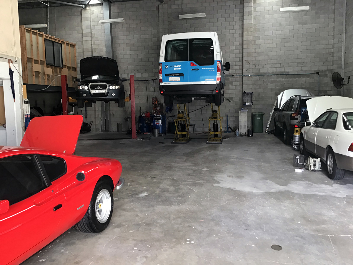 Our new workshop with various cars and a Renault Van